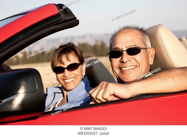 A hip senior Hispanic couple on a road trip in eastern Washington State, USA