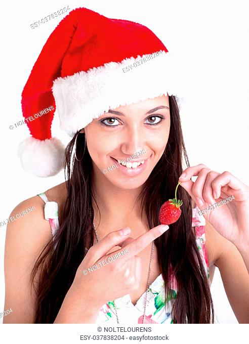 A young female model with a red christmas hoodie and strawberry in the hand
