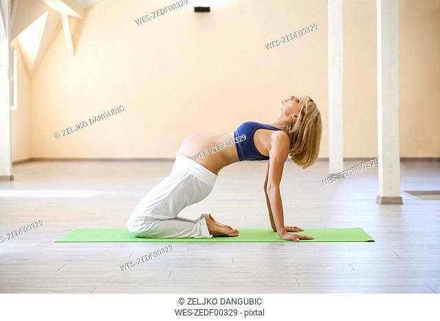 Prenatal yoga, woman doing bridge position