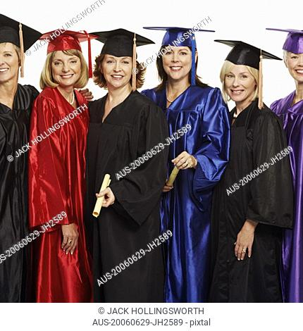 Portrait of a group of mature women wearing graduation gowns