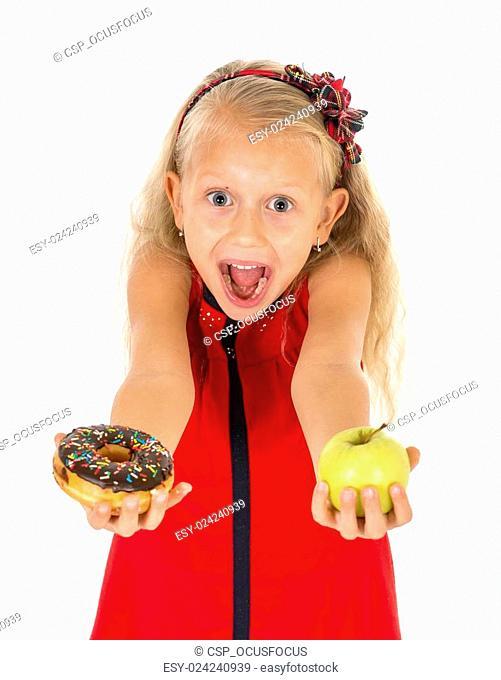 little beautiful blond child choosing dessert holding unhealthy chocolate donut and apple fruit