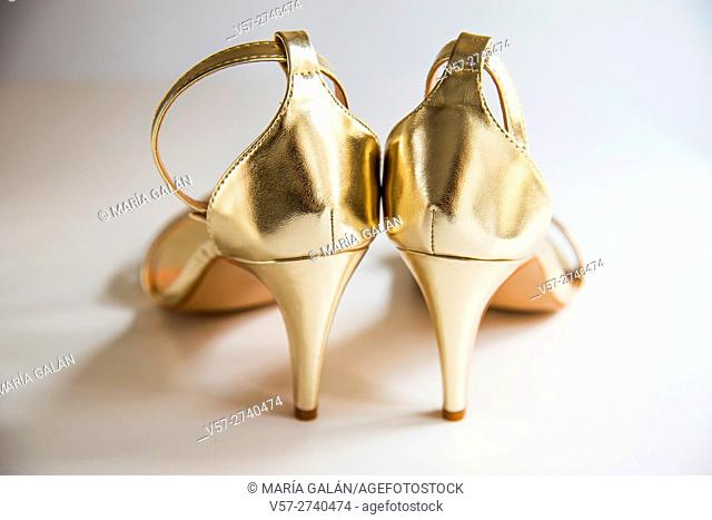 Golden high-heeled sandals