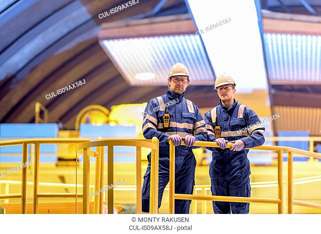 Portrait of workers in generating hall in hydroelectric power station