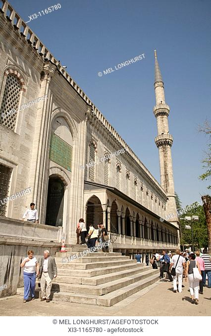 Tourists visiting Sultanahmet Mosque, also known as the Blue Mosque and Sultan Ahmed Mosque, Istanbul, Turkey