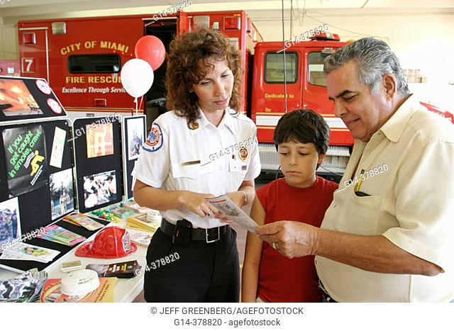 Firefighter giving safety information. Community Open House. Fire Station 7. Miami. Florida. USA
