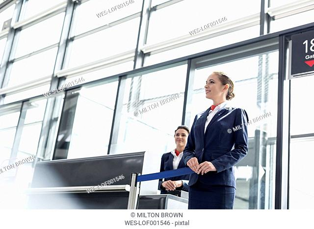 Two stewardesses at departure gate of an airport