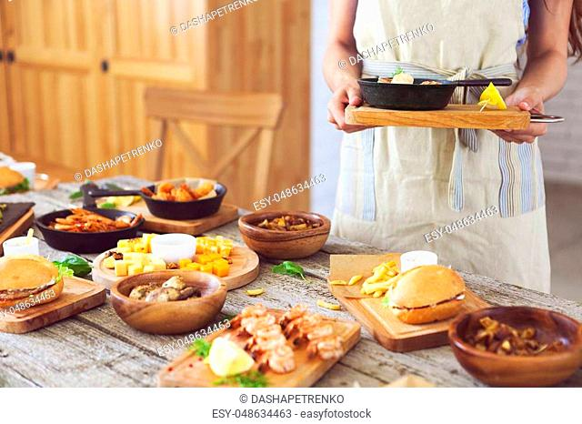 Waiter serving starters in a restaurant Stock Photos and Images