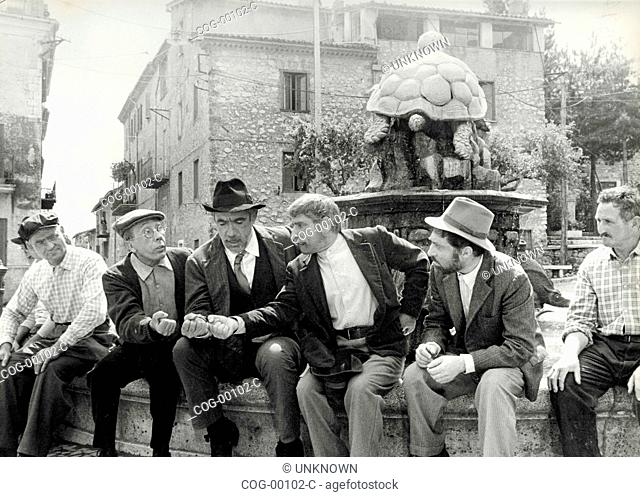 Actors Anthony Quinn and Renato Rascel play morra in a scene from the movie The Secret of Santa Vittoria, Italy