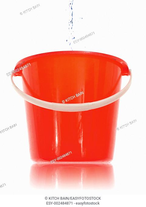 A cleaning bucket isolated against a white background