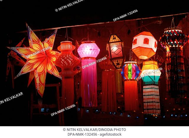 Various types of illuminated Lanterns ; Akashkandil kept for sale in shop for Diwali Festival ; Deepavali at Borivali ; Mumbai Bombay ; Maharashtra ; India