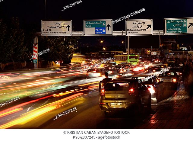 Heavy traffic at Meydan-e Azadi, Tehran, Iran, Asia