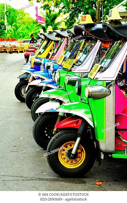 row of parked tuk-tuks, , Bangkok, Thailand