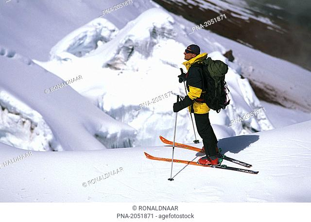 Skier descending Cotopaxi, an active vulcano in Ecuador