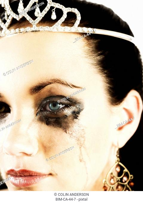 Woman wearing tiara and crying