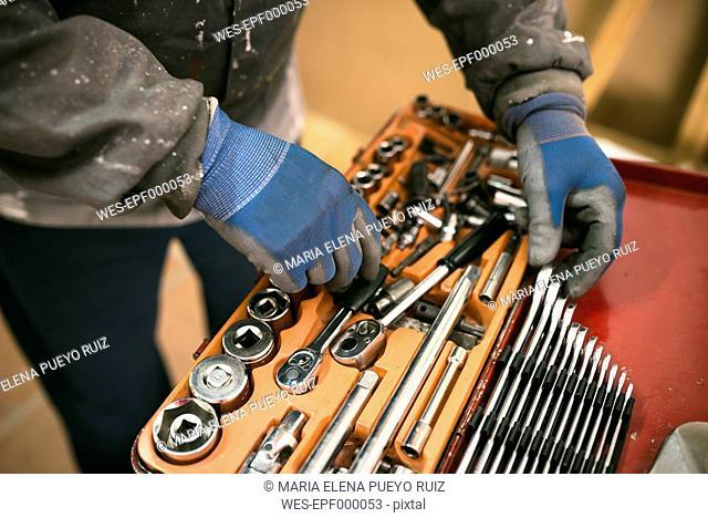 Senior man with tool box