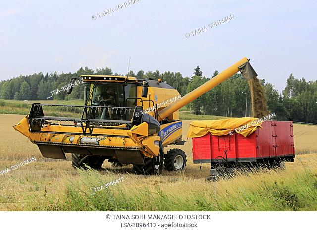 Salo, Finland - July 29, 2018. Harvesting barley in Salo, Finland. Grain harvest begins in South of Finland with LUKE's forecast of the smallest crop in 21st...