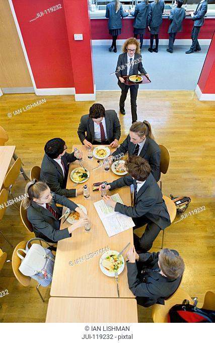 School children having lunch in school canteen