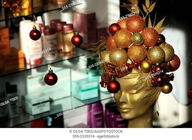 Beauty salon at Balmes street. Mannequin's head decorated at Christmas time. Barcelona, Catalonia, Spain