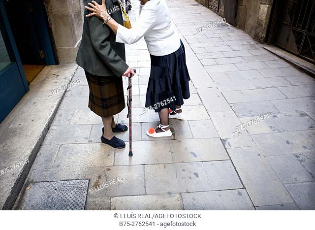 Two senior women greeting on the street. Barcelona, Catalonia, Spain