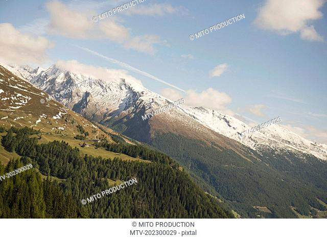 Low angle view of grossglockner mountain range against cloudy sky , Austria Alps, Carinthia, Austria