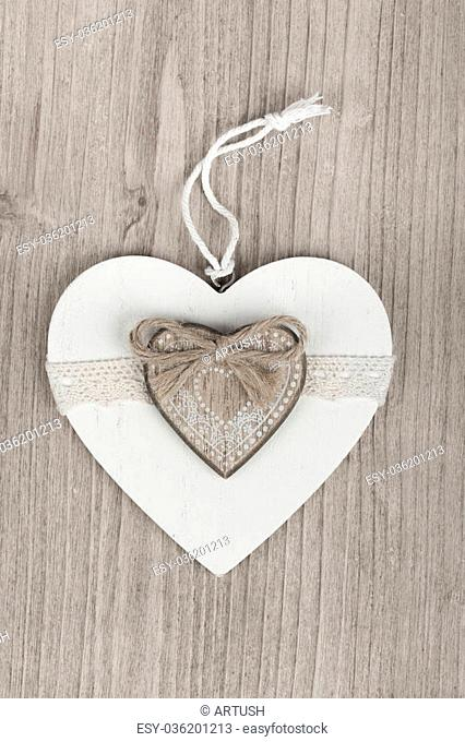 valentine's wooden hearts on a wooden background , valentine's day, day valentine postcard with space for text