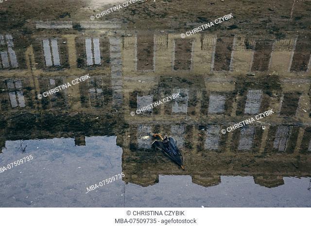 house facade reflecting in water, umbrella, Milan Street Photography, Italy