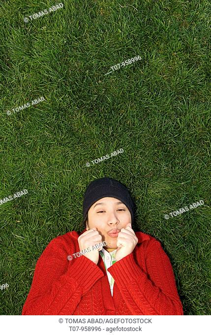 Young latino woman with read sweater