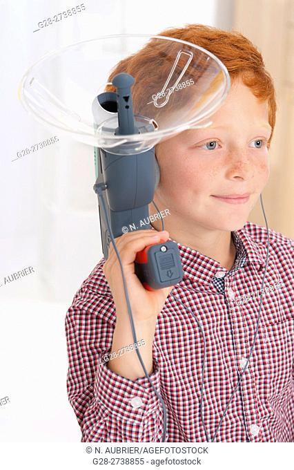 6 year old boy using a sound amplifying spy device