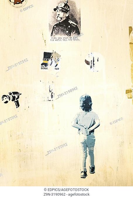 wall covered with stencil grafitti and stickers , rome, lazio, italy