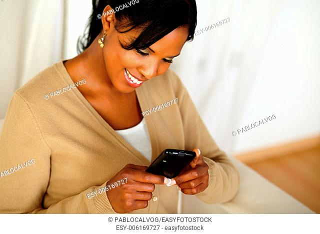 Top view portrait of a pretty adult woman reading a message on cellphone
