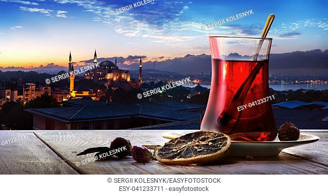 Turkish tea in the background of a mosque in Istanbul