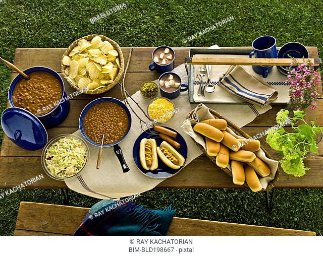 Picnic of beans, hot dogs and chips