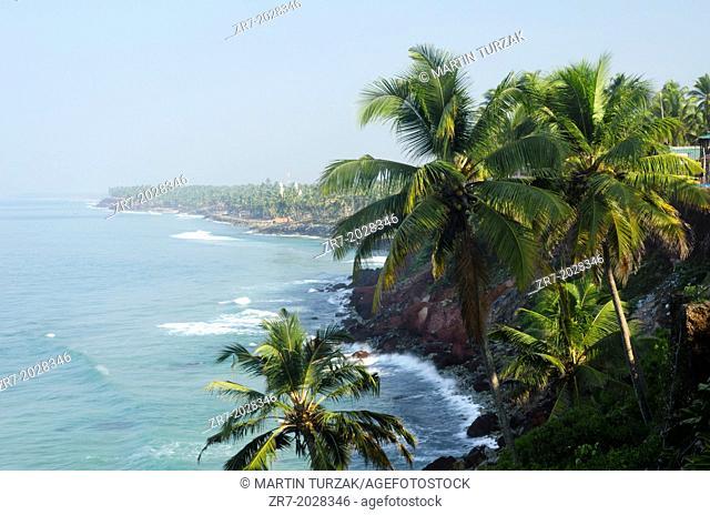 Palm-fringed beach in Varkala, Kerala, Indian Subcontinent