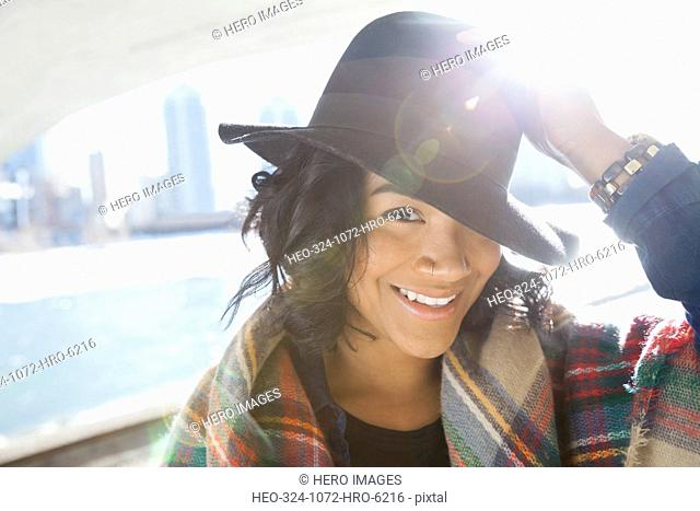 Portrait of smiling woman with hat