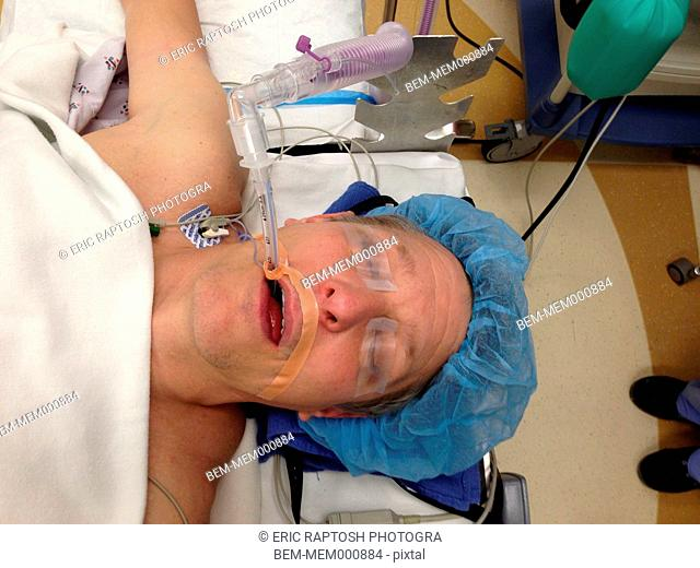 Caucasian woman under anesthetic in surgery