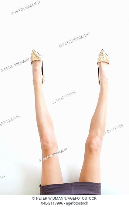 Female legs with high heeled shoes rising up (model-released)