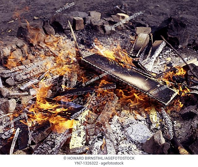 close view of flames and ashes of a fire burning rubbish
