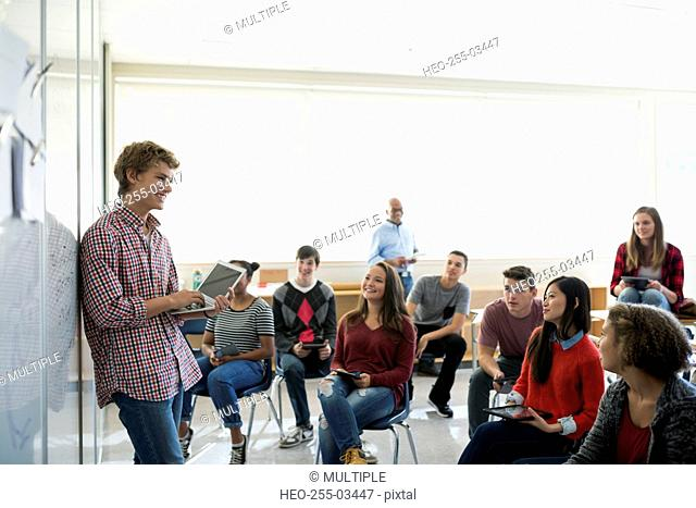High school student giving presentation in classroom