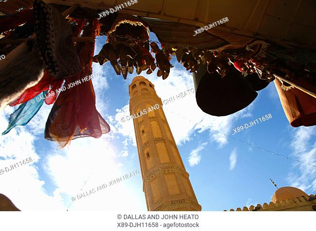 Africa, North Africa, Tunisia, Tozeur, Town Mosque Minaret and Hanging Dolls in Handicraft Shop