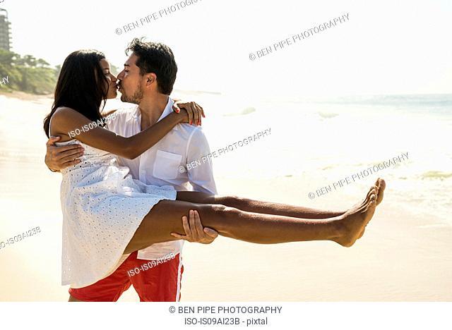 Couple kissing on Arpoador beach, Rio De Janeiro, Brazil