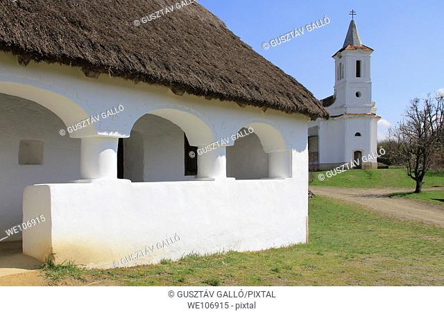 A country house porch and the church. Hungary, Szentendre, skanzen