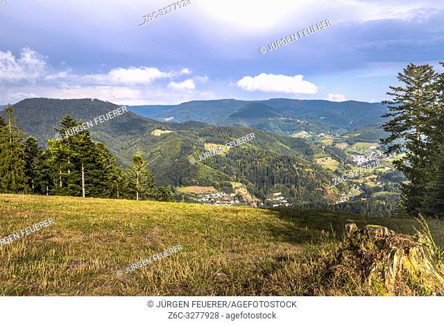 view to the valley and town of Bad Peterstal from above, with mountain crests of Black Forest, Germany
