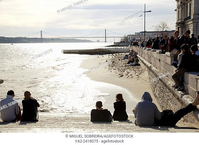 Strolling along Tagus River Promenade in Lisbon - Portugal