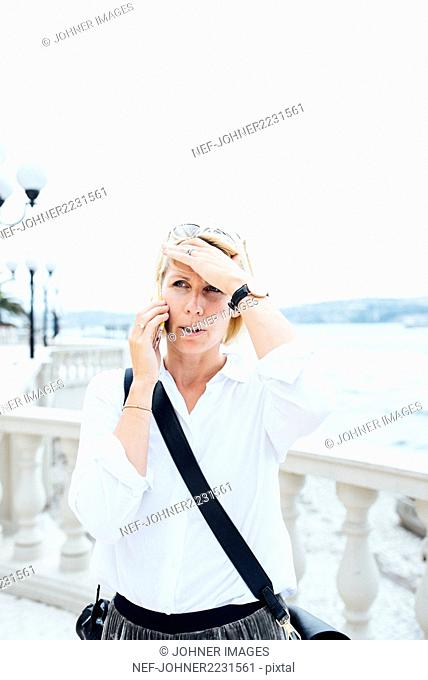 Woman talking via cell phone