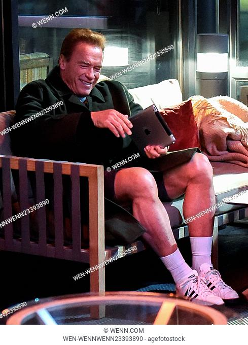 Arnold Schwarzeneggar sits and smokes a cigar in his shorts in Birmingham at his hotel. The Hollywood actor created a stir as people stopped to take photos of...