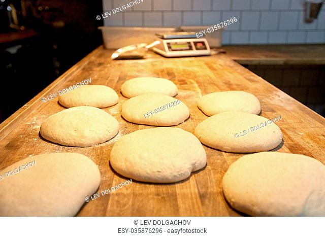 yeast bread dough on bakery kitchen table