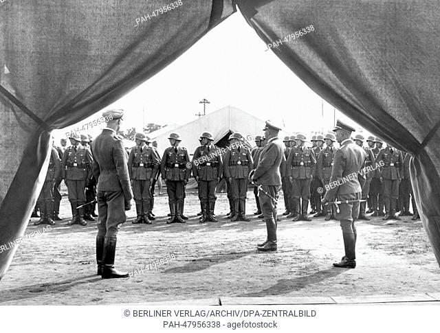 Nuremberg Rally 1937 in Nuremberg, Germany - Roll-call in full dress uniform in front of the tents of the camp of the German Wehrmacht (armed forces)