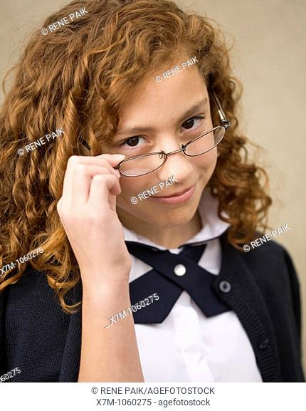School age girl with glasses in school uniform  Mixed race, Mexican and caucasian