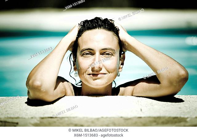 Young woman portrait on a swimming pool