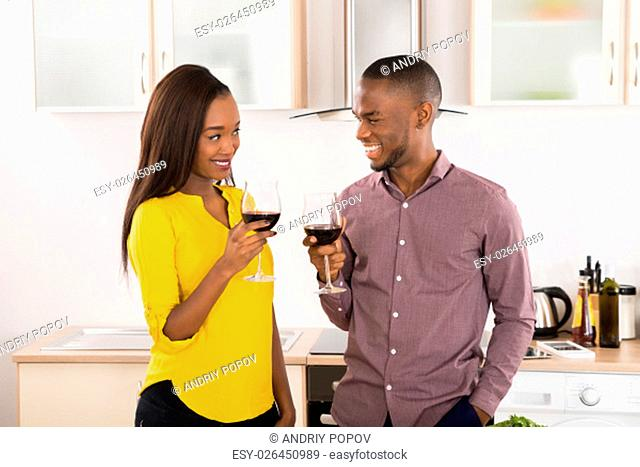 Young Happy African American Couple With Wineglasses